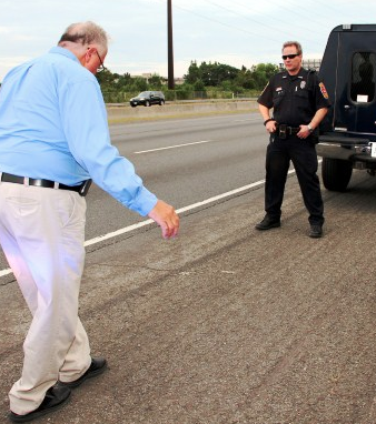 Thatcher conducting sobriety check at DUI Checkpoint