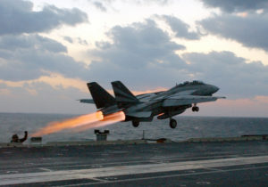 At sea aboard USS Kitty Hawk (CV 63) Nov. 14, 2002 -- An F-14 ÒTomcatÓ assigned to the Black Knights of Fighter Squadron One Five Four (VF-154) launches past steaming catapults on the bow of the ship. After an aircraft launches, steam is released as catapult pressure subsides. Kitty Hawk is the Navy's only permanently forward-deployed aircraft carrier and operates out of Yokosuka, Japan. U.S. Navy photo by Photographer's Mate 3rd Class Todd Frantom. (RELEASED)